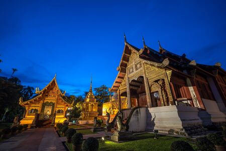 Famous Temple in Blue sky twilight time. Beautiful traditional architecture at Temple of Chiangmai Thailand, Asia.