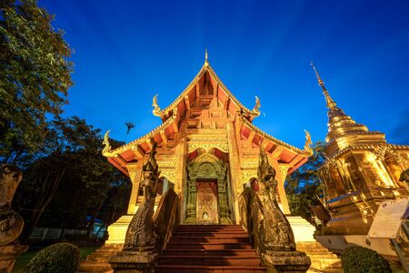Wat Phra Singh Temple is Famous Temple in Blue sky twilight time. Beautiful traditional architecture at Temple of Chiangmai Thailand, Asia.