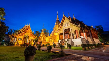 Wat Phra Singh Temple is Famous Temple in Blue sky twilight time. Beautiful traditional architecture at Temple of Chiangmai Thailand, Asia