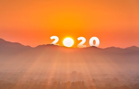 The word 2020 New year on mountain with sunrise sky and misty. Concept of a new beginning to success, Freedom and Happy new year