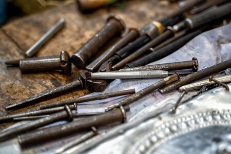 Silversmiths tools on the silver workplace