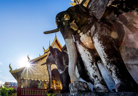 Stucco sculpture elephant surround the pagoda in an old temple , Wat Chiang Man Temple in Chiang Mai, Thailand