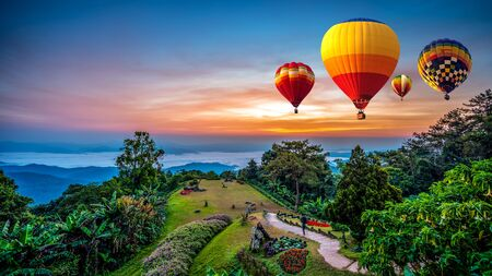 Hot air balloons adventure in nature over winter mountain in Chiang Mai, Thailand