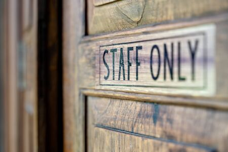 Staff only sign on wooden door, Staff Only Room Imagens - 131134206