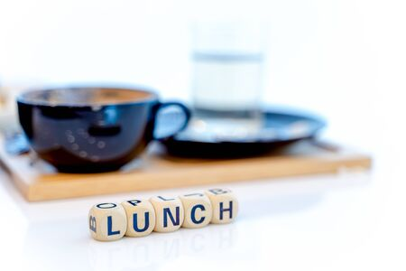 LUNCH word written on wood blocks on table. Imagens