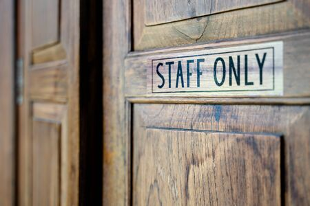 Staff only sign on wooden door, Staff Only Room