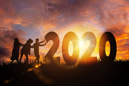 2020 New year Women working as a team to push 2020 towards their goals, Happy new year concept Imagens - 131134906