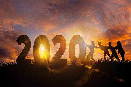 2020 New Year , Women team pushing 2020 New Year towards goals and success, Happy new year concept