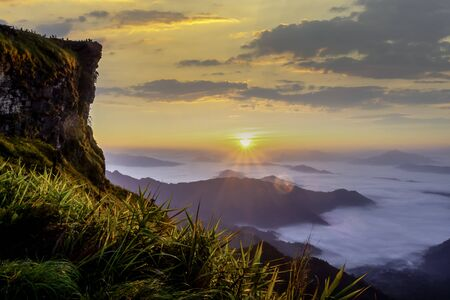 Beautiful landscape nature on peak mountain with sunset in winter at viewpoint Phu Chi Fa or Phu chee fah Forest Park in Chiang Rai, Thailand Banco de Imagens
