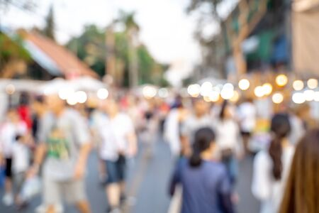 Blur people shopping in local street market for background usage, Vintage tone. Stock Photo