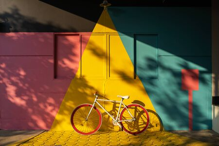 Bicycle against a vibrant wall outdoors, Ecological transportation concept. Stock fotó