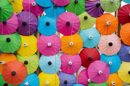 Colorful of Paper Parasols, Multi-colored umbrellas background and Textures.