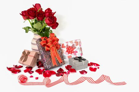 Fresh red roses, gift box and ribbon on white background. Valentines Day , Birthday or Wedding concept with copy space for your text. Stock fotó