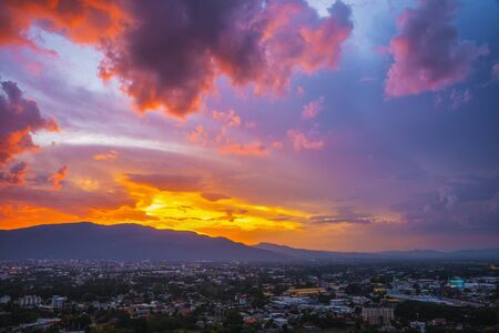 Beautiful panoramic aerial view of Orange clouds in evening. Chiang Mai, Thailand. Imagens