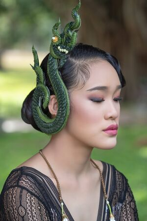 Beautiful young asian woman with Serpent king or king of naga shaped on the ear Imagens
