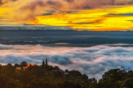 Wat Phra That Doi Suthep Temple with misty fog and sunlight morning on mountain important Landmark Travel Place of Chiang Mai, Thailand