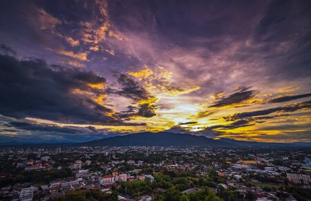 Aerial view Chiang Mai City skyline with dramatic rain clouds, Thailand