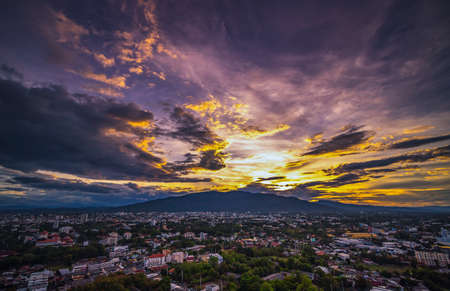 CHIANG MAI, THAILAND - June 6,2020:   Aerial view Chiang Mai City skyline with dramatic rain clouds, Thailand