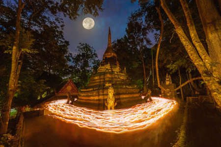 CHIANG MAI, THAILAND - JULY 5, 2020 : Lights from the candle lit at night around the church of Buddhist in Thailand