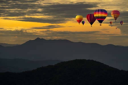 Colorful Hot Air Balloons over mountain in sunrise or sunset, Chiang Mai in Thailand