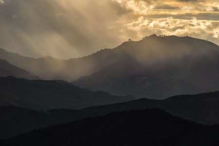 Landscape of Distant mountain range and layer in morning sun ray and white fog at the valleys, Chiang Mai in Thailand