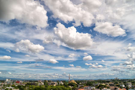 White clouds moving fast over city buildings in Chiang Mai City, North Thailand.