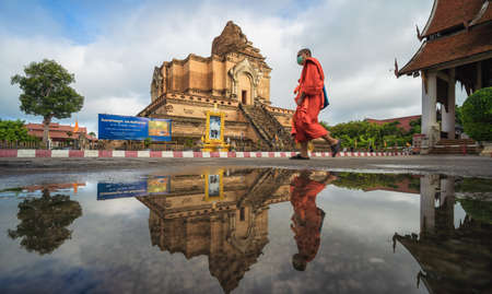 CHIANG MAI, THAILAND - JULY 9, 2020: Reflection remains of the historical Buddhist temple known as Wat Chedi Luang, in Chiang Mai, Thailand. Editorial
