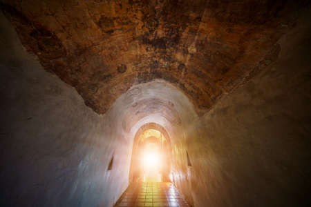 The Light at the End of the Tunnel. End of mystery tunnel background with old brick.