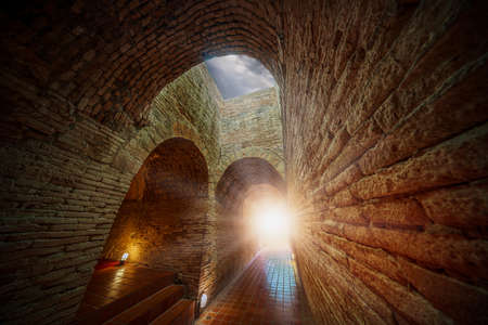 The Light at the End of the Tunnel. Tunnel with sunlight coming from the exit. Editorial