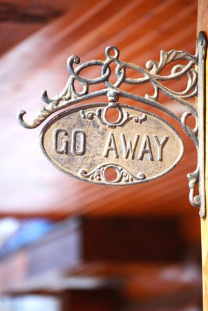 unwelcome: Unwelcome sign at entry to log home