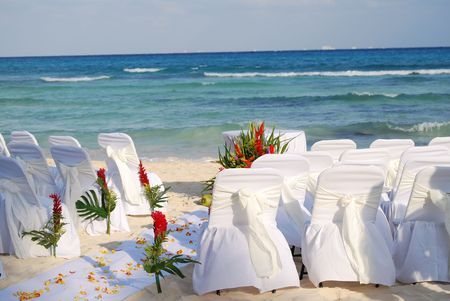 Chairs waiting for an approaching wedding on the beach