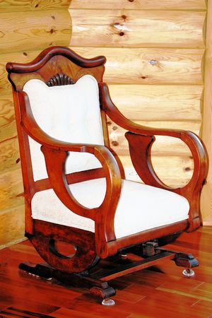 antique chair: Antique cherry wood rocking chair Stock Photo