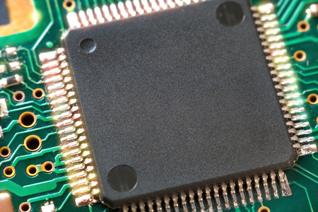 The chip on the hard drive board. Close-up.