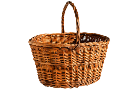 Empty wicker basket with a handle isolated on a white background. Preparation for the designer. Front view.