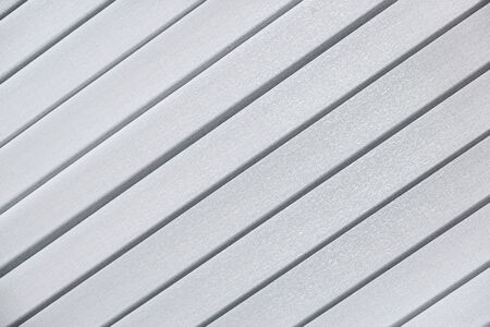Inclined diagonal gray lines. Textile background of modern blinds. Abstraction