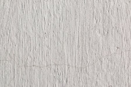 Abstract background. The surface of the white limestone wall with texture and roughness.