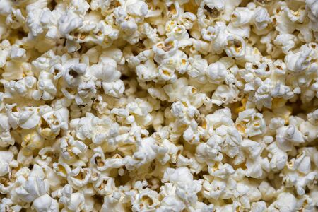 A scattering of cooked popcorn. View from the top. Background.