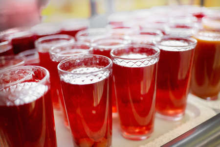 Glass glasses with natural compote and juice