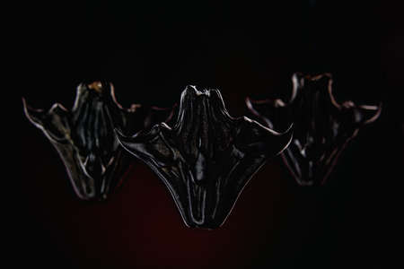 group of horned demons on a dark background. Army of evil from the underworld Zdjęcie Seryjne
