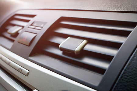 Close-up of the fan or air conditioner grilles in the car interior. Airing the car