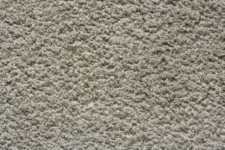 The rough surface of cement plaster background. Empty surface close-up.