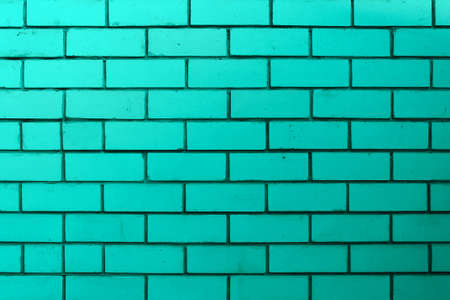 The brick wall is turquoise or green. Empty and clean surface with brickwork. Background blank for design