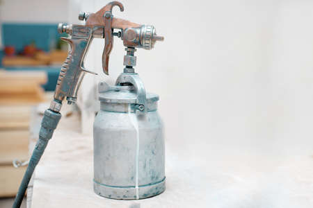 spray gun close-up. tool for industrial painting of materials and iron. Copy space