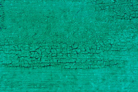 Fashionable aquamarine background for an ad or advertisement. An empty surface with a cracked texture