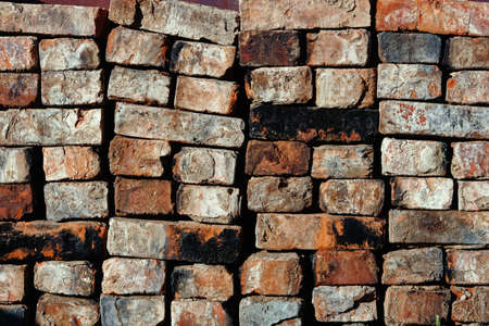 folded old red brick background. The old building material is stacked. Abstract texture background 免版税图像 - 159135878