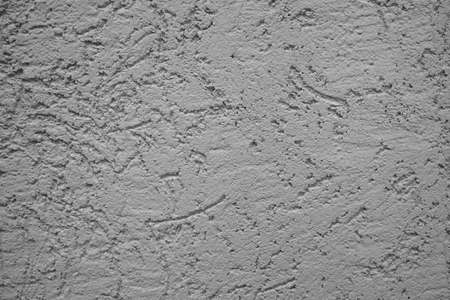 The wall is made of plaster with scratches. Rough surface. abstract gray background. A template for the design of a website or ad. 免版税图像 - 159135879