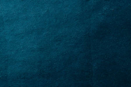 Abstract background made of rough craft paper. Blank surface for dark blue design