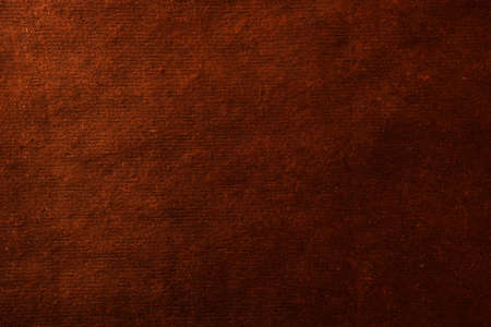 Abstract background from rough craft paper. Empty surface in orange color for design