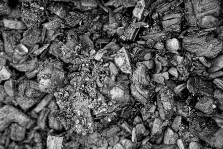 Smouldering ruins. Abstract background of burnt coals and ash. Empty surface 免版税图像 - 159352025