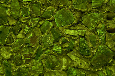 Abstract background made of large stone. Empty stone surface of green color. Blank for design. 免版税图像